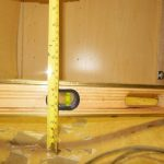 "Vertical deflection of shelf (2.25"") and veneer loss (for cabinet filled with 1"" of water; none otherwise)"